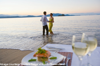 couple dining on Dunk Island beach